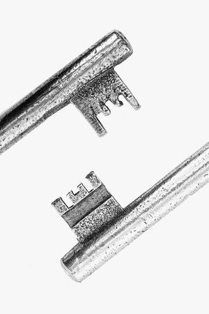 side keys: Macro two old keys on white background