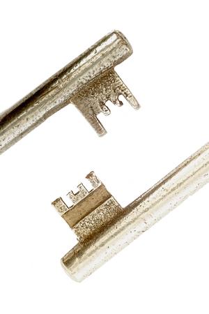 old macro: Macro two old keys on white background