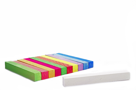 white chalks: View of flying a group of colored chalks on a white background