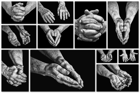 recluse: Collage hands of elderly persons on a black background Stock Photo