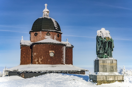 Sculpture Cyril and Methodius church on a background on top of the mountain Radhost in winter Stock Photo
