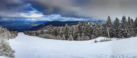 Panoramic view of the winter landscape from Mount RadhostCzech Republic