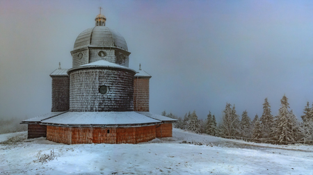 Wooden church at the top of Radhost mountain in winter