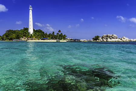 View of Lengkuas Island with white lighthouse / Belitung-Indonesia / Stock Photo