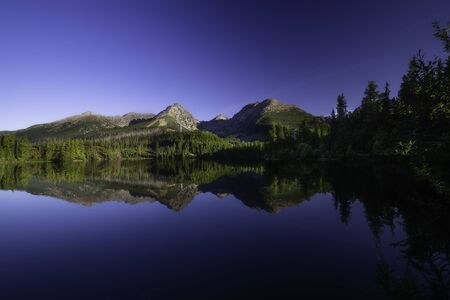 View of Strbske pleso with reflection of High Tatras on background from Slovakia