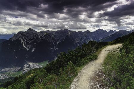View from the mountain saddle Kreuzjoch the mountains of the Tyrolean Alps in Austria