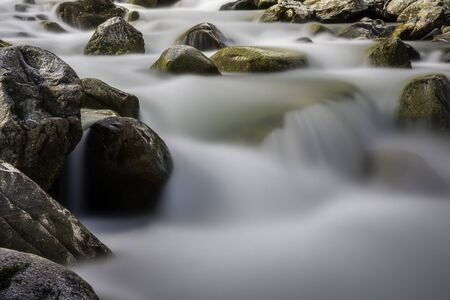 Group large stones in a mountain stream flowing Stok Fotoğraf