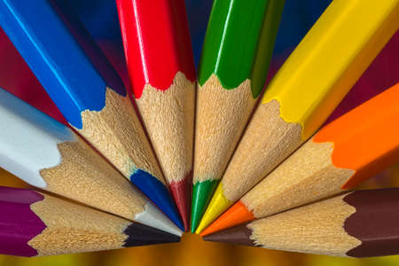 Close-up view of a group of lying differently colored crayons