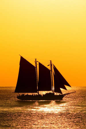 yellow boats: Sailboat against a beautiful sunset in Key West