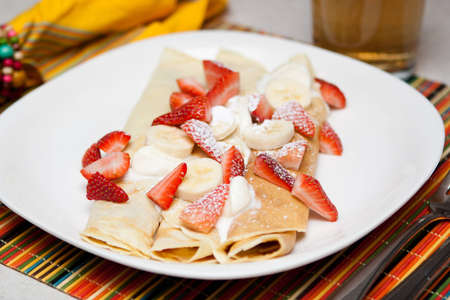 swedish: Crepes with strawberry, banana and whip cream