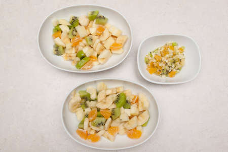 Adult and baby serving of fruit sallad