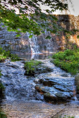This is a view of waterfall in Karkonosze Mountains, Poland.