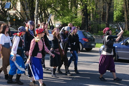 congregate: Euro 2012 opening at universities - students march on the street in costumes. Lublin, 4.May.2011 Editorial