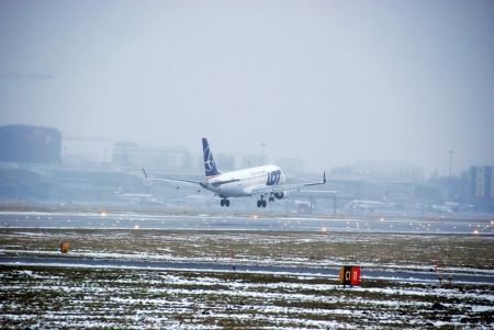 chopin: Warsaw City, Poland - February 16, 2013 - Aeroplane flight over the Chopin Airport in Warsaw