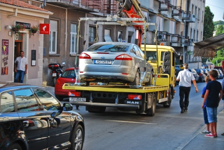 View of truck towing the bad parked car in Pula, Croatia  August 8, 2013