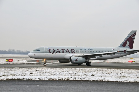 This is a view of Qatar Airways plane registered as A7-AHE on the Warsaw Chopin Airport. December 31, 2014. Warsaw, Poland