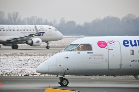 warsaw chopin: This is a view of Eurolot plane Bombardier Q400 registered as SP-EQB on the Warsaw Chopin Airport. December 31, 2014. Warsaw, Poland