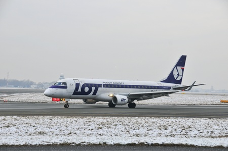 chopin: This is a view of LOT-Polish Airlines plane Embraer ERJ170 registered as SP-LIC on the Warsaw Chopin Airport. December 31, 2014. Warsaw, Poland. Editorial