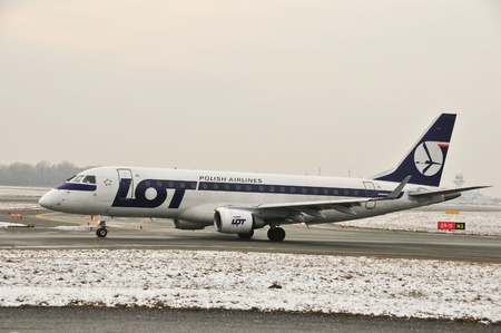 warsaw chopin: This is a view of LOT-Polish Airlines plane Embraer ERJ 170 registered as SP-LID on the Warsaw Chopin Airport. December 31, 2014. Warsaw, Poland.