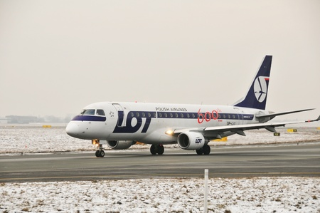 warsaw chopin: This is a view of LOT-Polish Airlines plane Embraer ERJ 170 registered as SP-LII on the Warsaw Chopin Airport. December 31, 2014. Warsaw, Poland