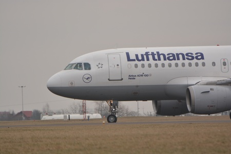 luft: This is a view of Lufthansa plane Airbus A319-114 registered as D-AILS. February 19, 2015. Lublin Airport in Swidnik, Poland. Editorial