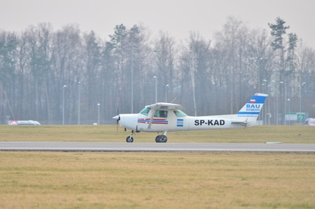 cessna: This is a view of small plane Cessna over the Lublin Airport. March 10, 2015. Lublin Airport in Swidnik, Poland.