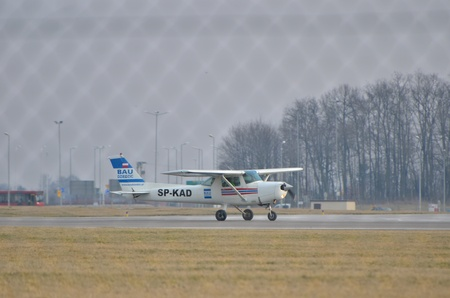 small plane: This is a view of small plane Cessna over the Lublin Airport. March 10, 2015. Lublin Airport in Swidnik, Poland.