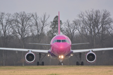 jetplane: This is a view of Wizzair plane Airbus A320-232 registered as HA-LYA on the Lublin Airport. March 29, 2015. Lublin Airport in Swidnik, Poland.