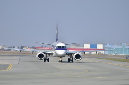 chopin: This is a view of Embraer ERJ 170 PLL LOT registered as SP-LNA on the Warsaw Chopin Airport. April 11, 2015. Warsaw, Poland.