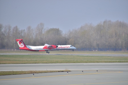 bombardier: This is a view of Air Berlin plane Bombardier Q400 Dash-8 registered as D-ABQF on Warsaw Chopin Airport. April 11, 2015. Warsaw, Poland.