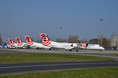 This is a view of four Eurolot planes Bombardier Q400 Dash-8 on the Warsaw Chopin Airport. Planes were parked on March 31, 2015 after the Eurolot company went bankrupt. April 11, 2015. Warsaw, Poland. Sajtókép