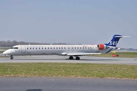 jetplane: This is a view of SAS Scandinavian Canadair CRJ plane registered as OYKFK on the Warsaw Chopin Airport. April 11 2015 Warsaw Poland.