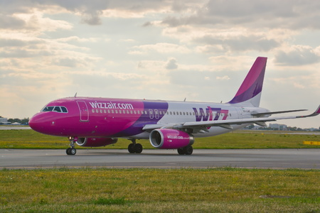 warsaw chopin: This is a view of airlines Airbus A320 plane registered as HA-LWX on the Warsaw Chopin Airport. July 30, 2015. Warsaw, Poland. Editorial