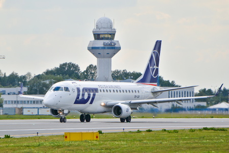warsaw chopin: This is a view of LOT - Polish Airlines Embraer ERJ 170 plane STD registered as SP-LDF on the Warsaw Chopin Airport. July 30, 2015. Warsaw, Poland.
