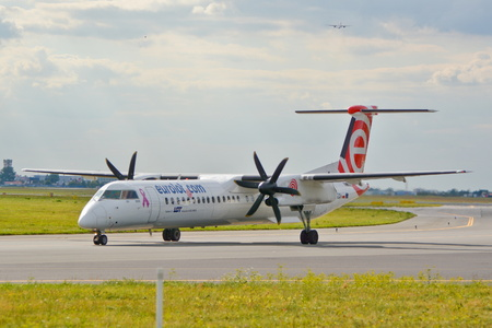 bombardier: This is a view of Eurolot plane Bombardier Dash-8 Q400 registered as SP-EQH on the Warsaw Chopin Airport. July 30, 2015. Warsaw, Poland. Editorial