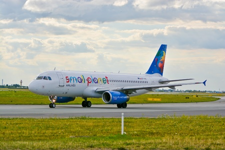 warsaw chopin: This is a view of Small Planet Poland Airbus A320 plane registered as SP-HAC on the Warsaw Chopin Airport. July 30, 2015. Warsaw, Poland.