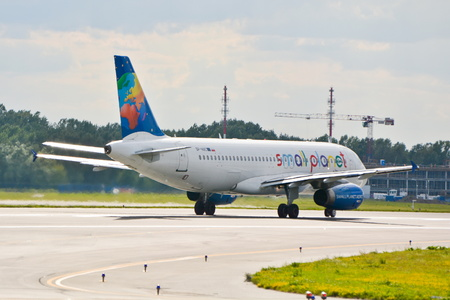 chopin: This is a view of Small Planet Poland Airbus A320 plane registered as SP-HAC on the Warsaw Chopin Airport. July 30, 2015. Warsaw, Poland.