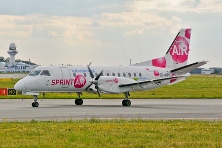 warsaw chopin: This is a view of Sprintair plane Saab 340A registered as SP-KPC on the Warsaw Chopin Airport. July 30, 2015. Warsaw, Poland. Editorial