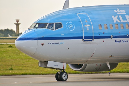 warsaw chopin: This is a view of KLM Group, Boeing 737 plane registered as PH-BGI on the Warsaw Chopin Airport. July 30, 2015. Warsaw, Poland.