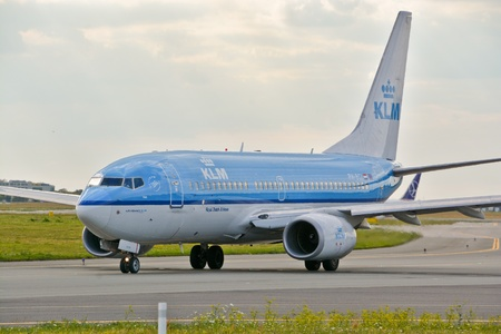 klm: This is a view of KLM Group, Boeing 737 plane registered as PH-BGI on the Warsaw Chopin Airport. July 30, 2015. Warsaw, Poland.