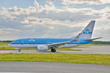 chopin: This is a view of KLM Group, Boeing 737 plane registered as PH-BGI on the Warsaw Chopin Airport. July 30, 2015. Warsaw, Poland.