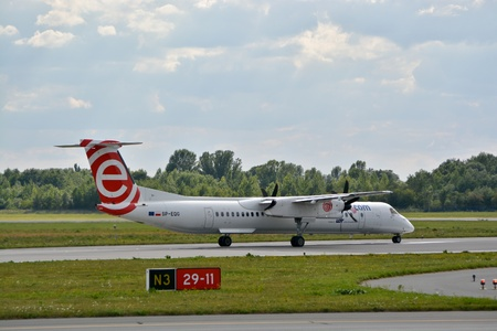 aircrew: This is a view of Eurolot plane Bombardier Dash 8 Q400 registered as SP-EQG on the Warsaw Chopin Airport. July 30, 2015. Warsaw, Poland.