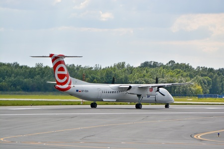 bombardier: This is a view of Eurolot plane Bombardier Dash 8 Q400 registered as SP-EQG on the Warsaw Chopin Airport. July 30, 2015. Warsaw, Poland.