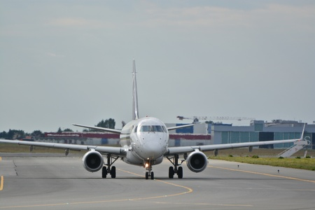 warsaw chopin: This is a view of LOT Polish Airlines Embraer ERJ 170 plane STD registered as SP-LDI on the Warsaw Chopin Airport. July 30, 2015. Warsaw, Poland. Editorial