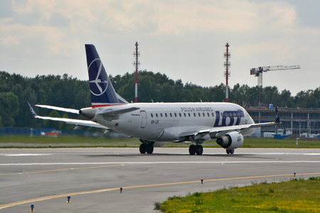 std: This is a view of LOT Polish Airlines Embraer ERJ 170 plane STD registered as SP-LDI on the Warsaw Chopin Airport. July 30, 2015. Warsaw, Poland. Editorial