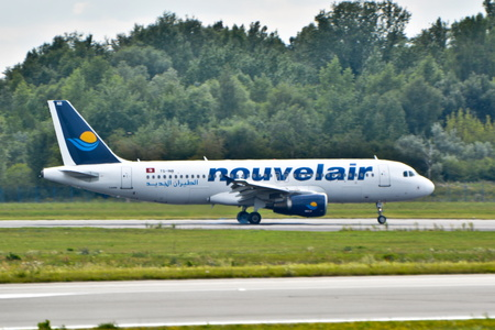 tunisie: This is a view of Nouvelair Tunisie Airbus A320-214 plane registered as TS-INR on the Warsaw Chopin Airport. July 30, 2015. Warsaw, Poland. Editorial