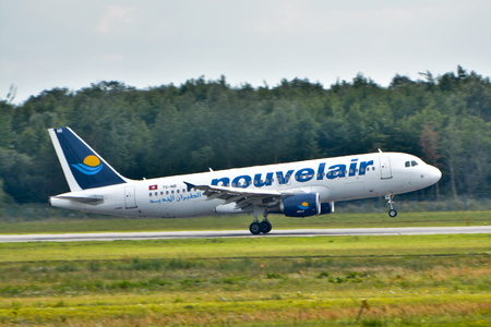 warsaw chopin: This is a view of Nouvelair Tunisie Airbus A320-214 plane registered as TS-INR on the Warsaw Chopin Airport. July 30, 2015. Warsaw, Poland. Editorial