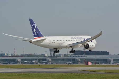 warsaw chopin: This is a view of LOT Polish Airlines Boeing 787-8 Dreamliner plane on the Warsaw Chopin Airport. September 16, 2015, Warsaw, Poland.