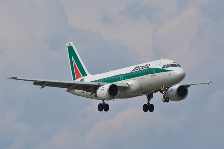 warsaw chopin: This is a view of the Al Italia plane Airbus A319 registered as EI-IMF on the Warsaw Chopin Airport. September 16, 2015, Warsaw, Poland. Editorial