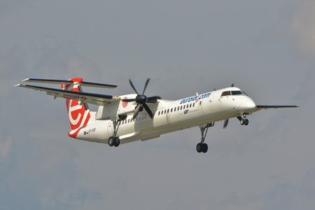 bombardier: This is a view of the Eurolot plane Bombardier Dash 8 Q400 registered as SP-EQB on the Warsaw Chopin Airport. September 16, 2015, Warsaw, Poland.